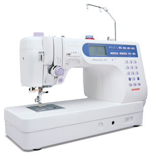 Janome Memory Craft 6500 Professional Sewing Machine + Bonus